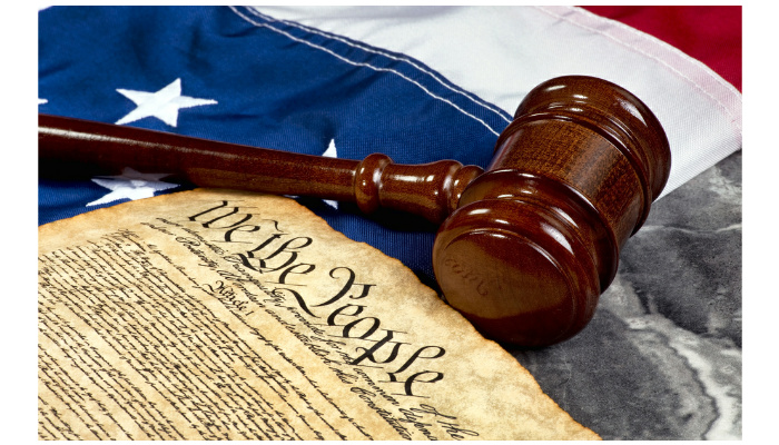 wooden-gavel-on-top-of-american-flag-and-bill-of-rights-document-shutterstock-image-id497639149-copyright-mj007